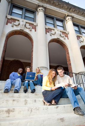students sitting on campus steps